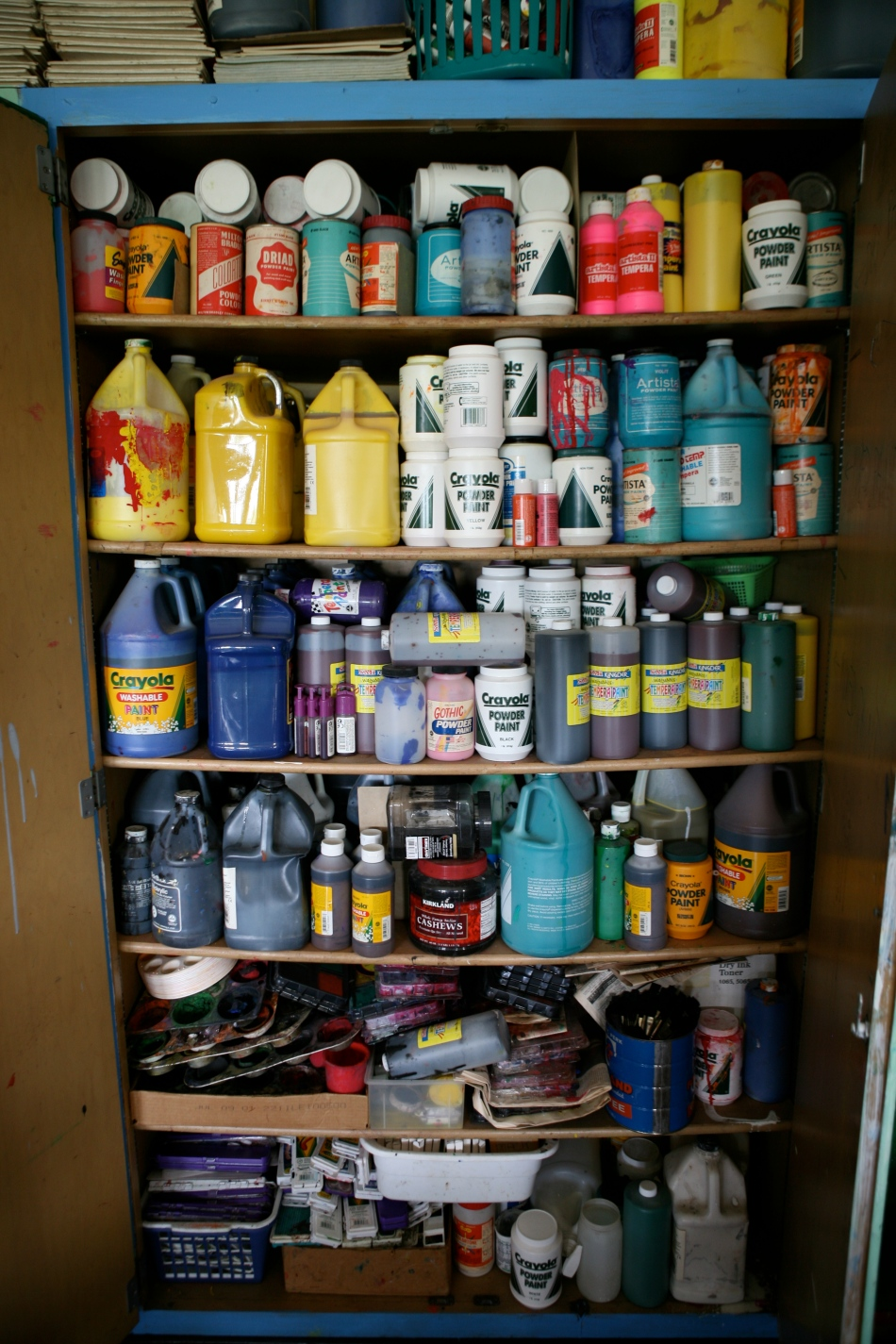 Cupboard Full of Paint in the Art Room