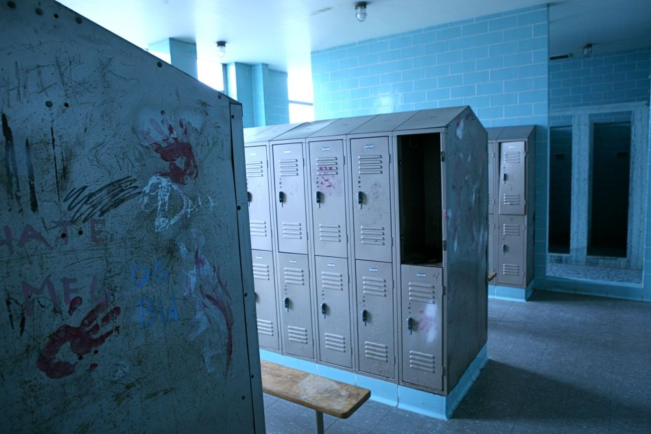 Tiles echo the metal lockers' noise.  The smell.