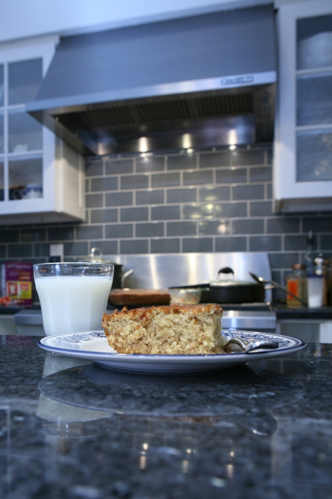 Midnight Snack of Banana Cake and Milk on Black Granite Counter