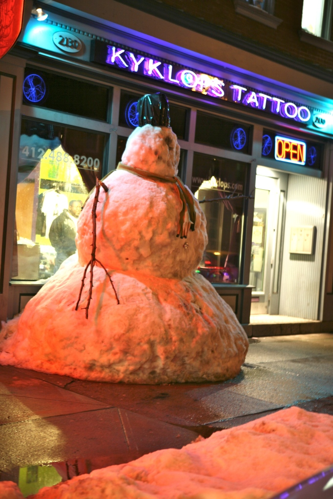 Snow Cyclops in front of Tattoo Parlor