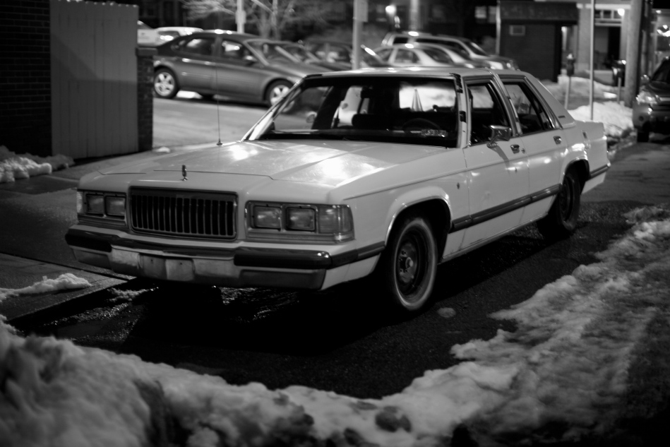 Lincoln Town Car Parked in the Snow Vintage