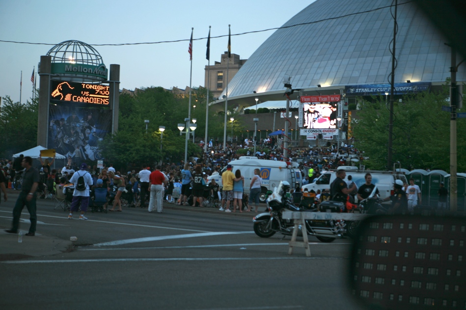 Giant TV downtown at Mellon Arena. People actually have a plaid couch. Streets closed.