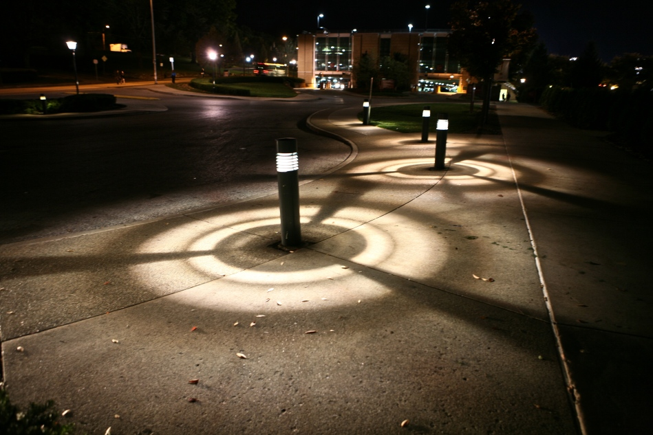 Shadow patterns on the concrete from the lights at CMU.