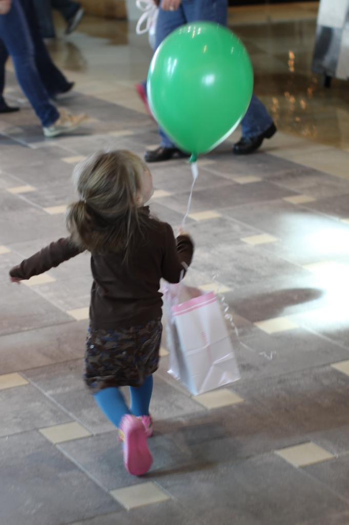 At the mall after buying a pair of pink shoes for her birthday
