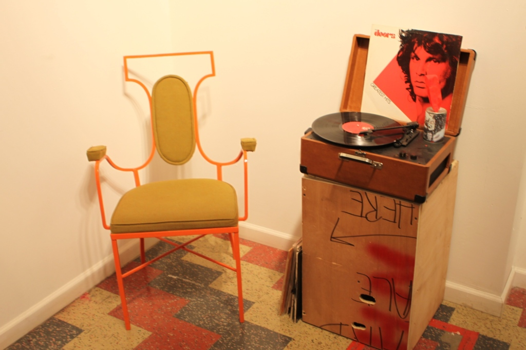 Jim Morrison and the Doors recorde on a turntable.