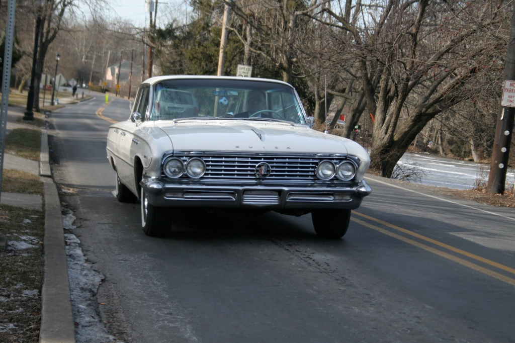 Man driving a1960 Buick on a York PA road with Fuzzy Dice