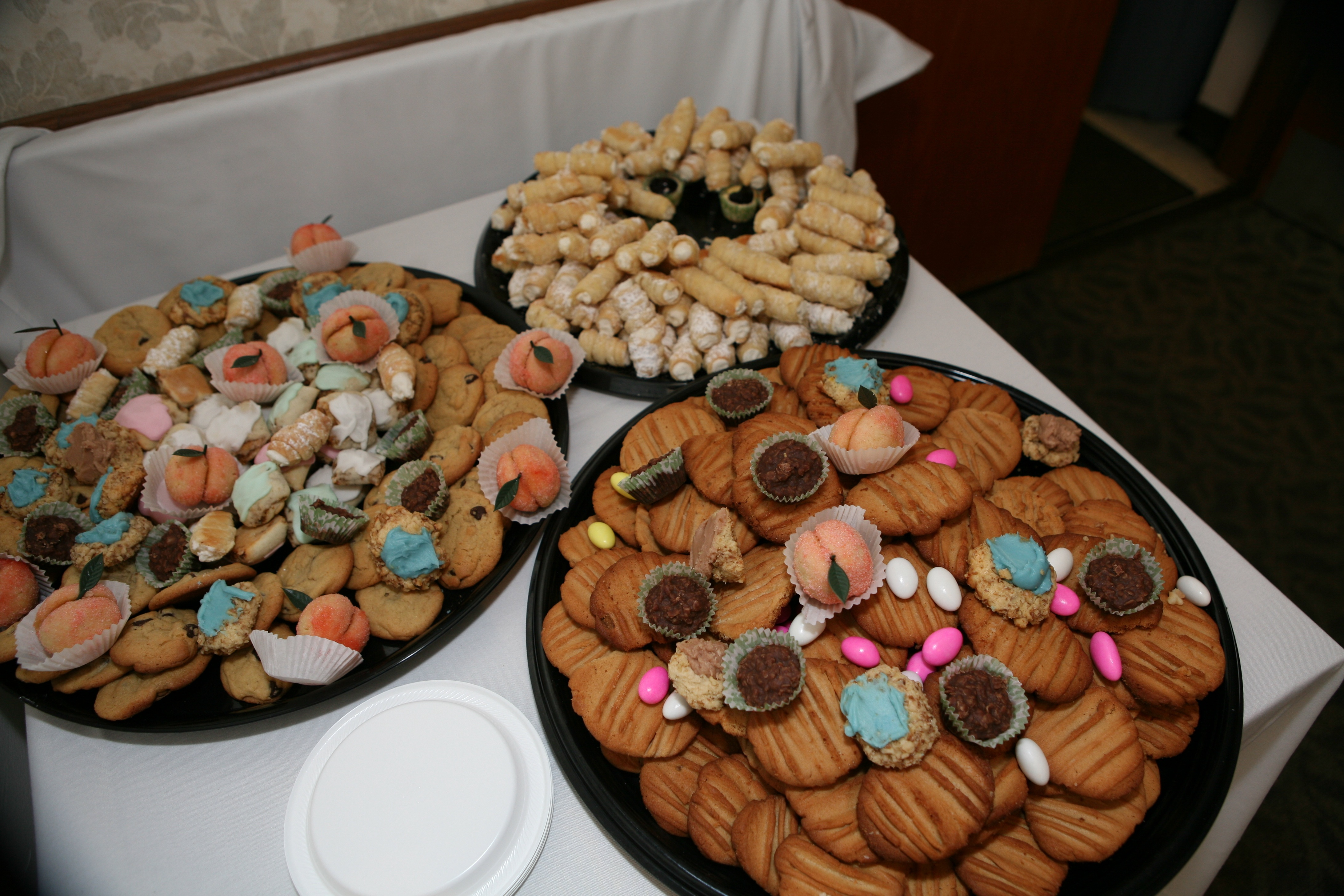 these cookie tables are all from the same wedding