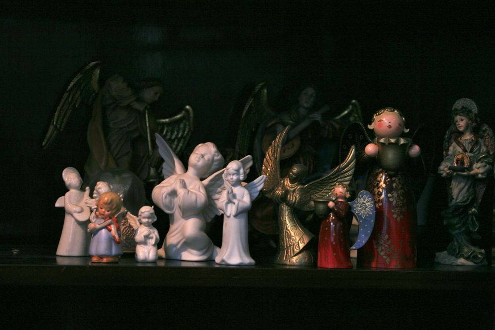 2009- from the archivesThese angels are on a shelf in one of the built in china closets in the dining room.