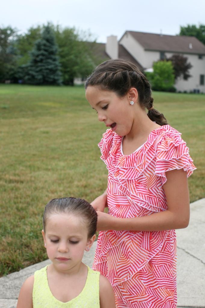 Sisters fixing her sisters hair