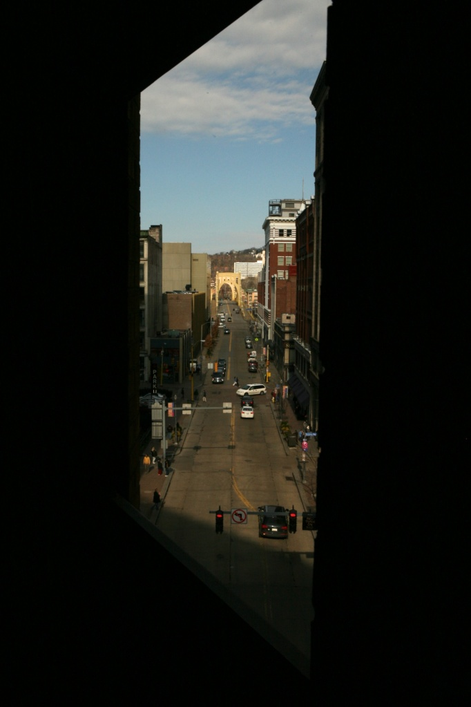 9th street bridge through a parking lot window