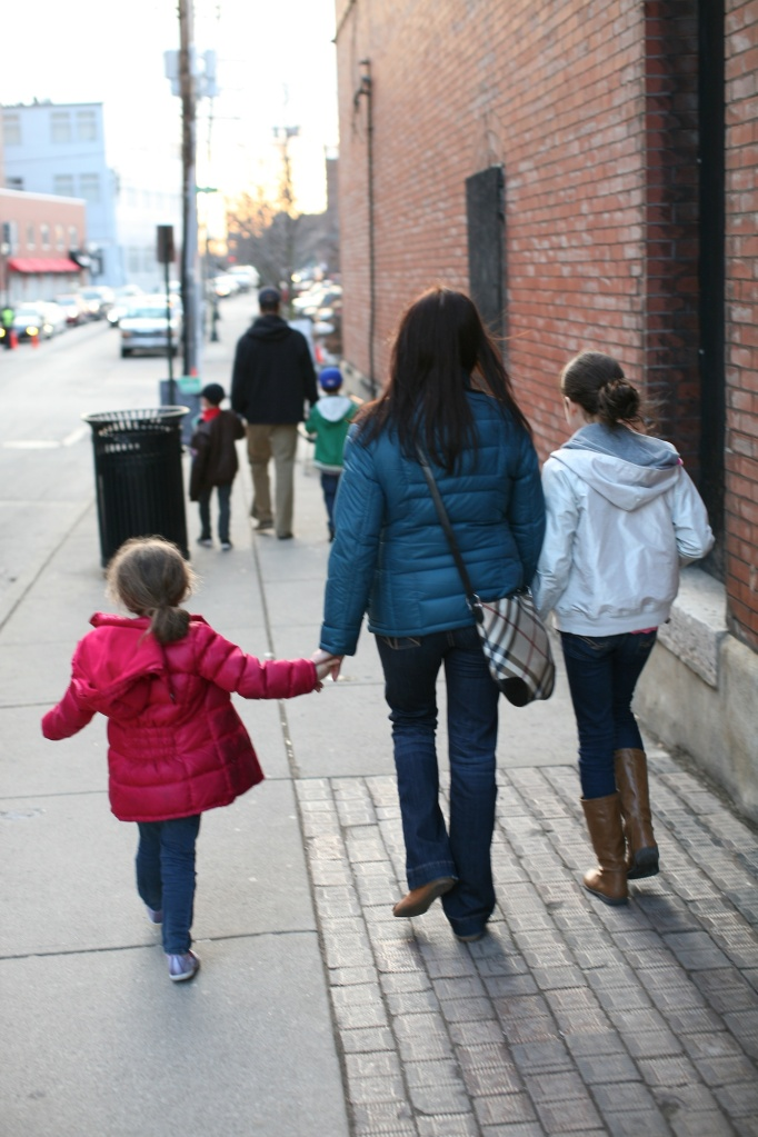 family on the downtown sidewalk