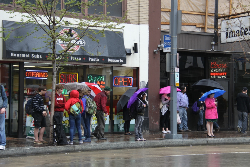 People Waiting for Bus in Rain
