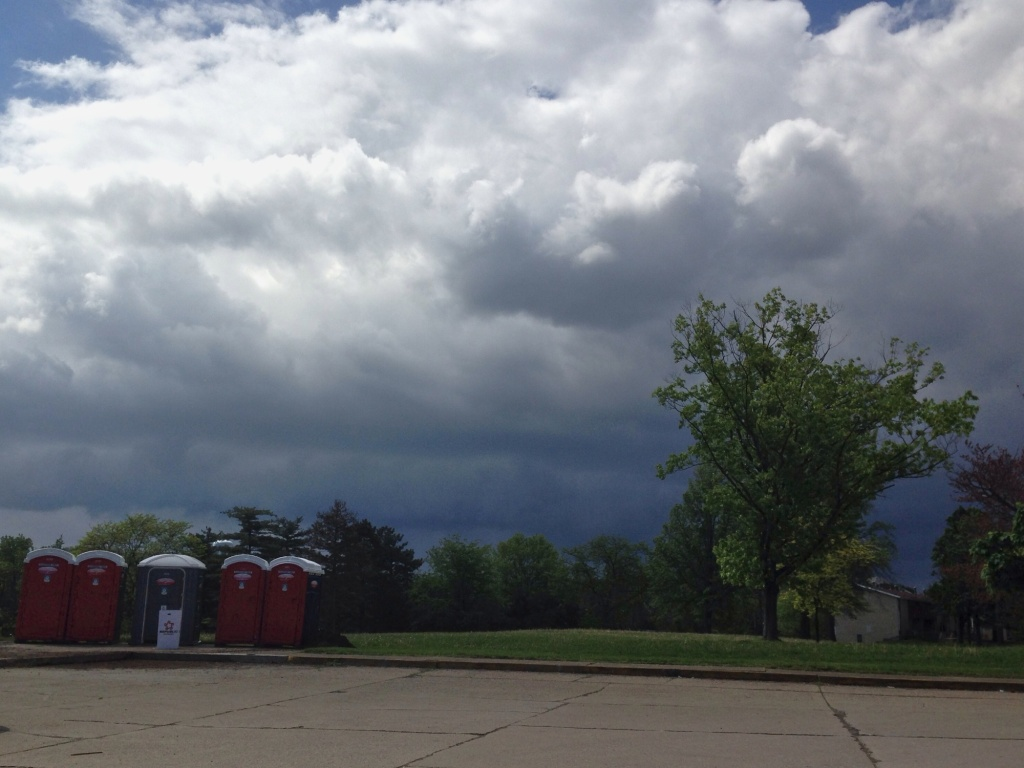 outhouses and a threateneing sky