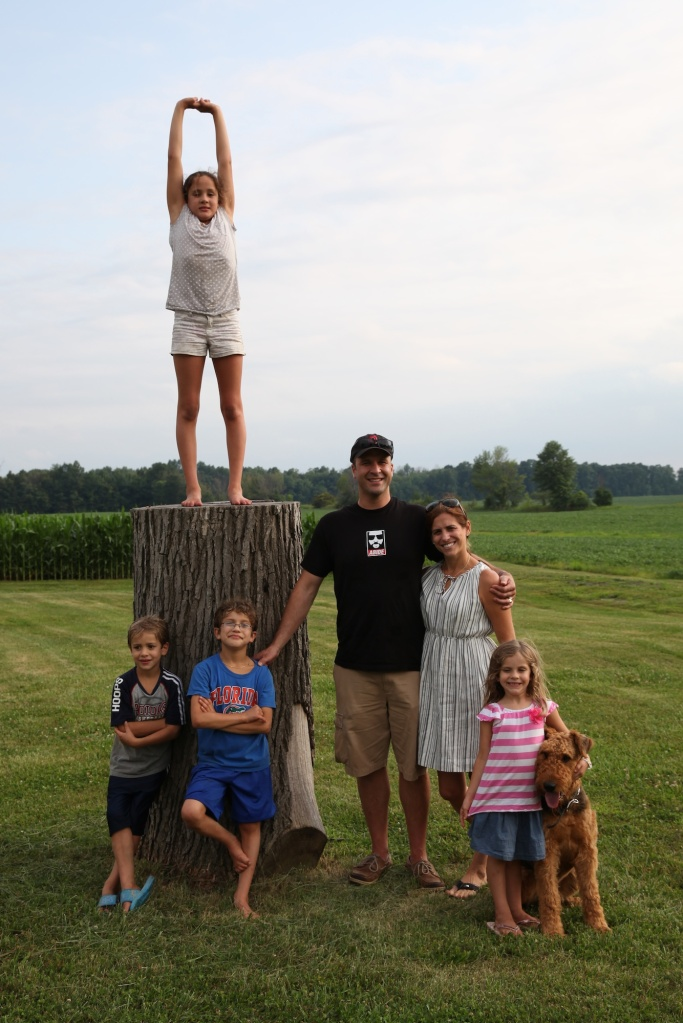 family on stump