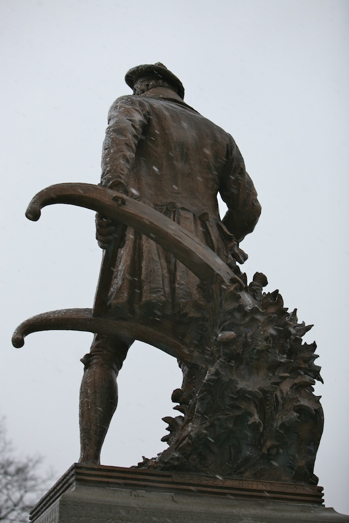 Burns statue with plow