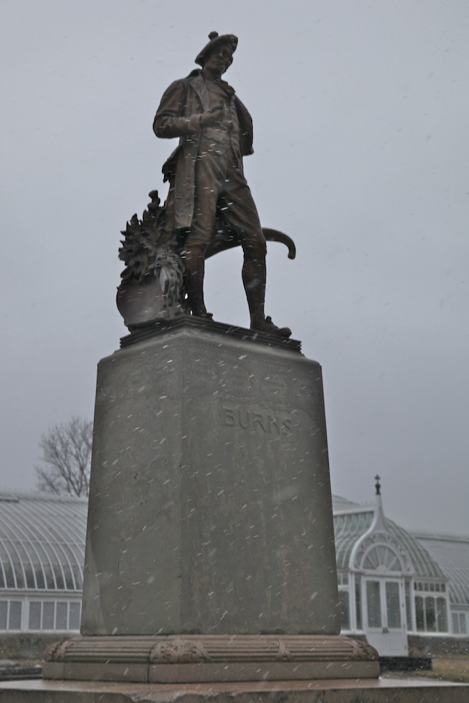 Burns statue with snow front