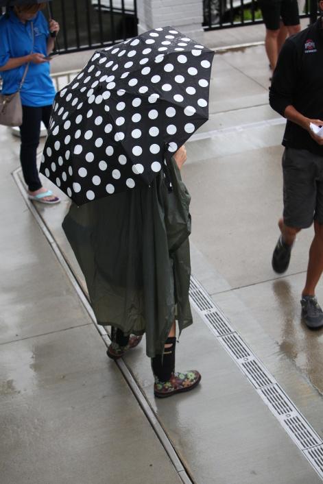 spectator in the rain
