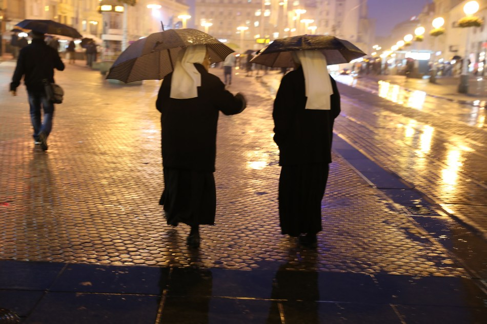 Pair of nuns in the rain