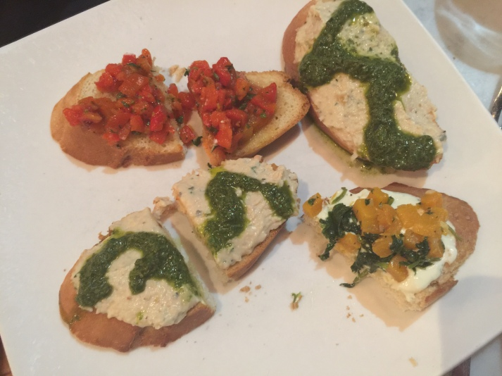 Bruschette butternut squash and greens with mint chevre, cannellini bean spread with basil pesto, and red pepper tapenade